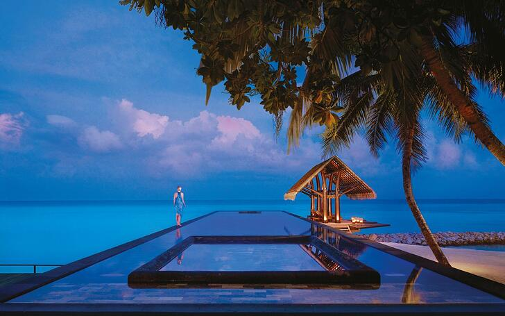 One-and-Only-Reethi-Rah-lap-pool-during-the-evening.jpg