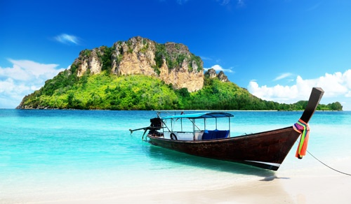 Indonesian boat to island with beautiful clear water